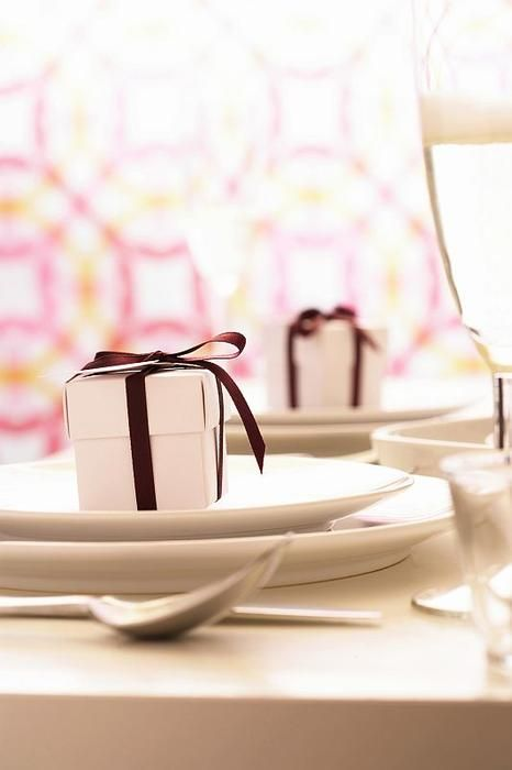 Simple Christmas table setting with a gift