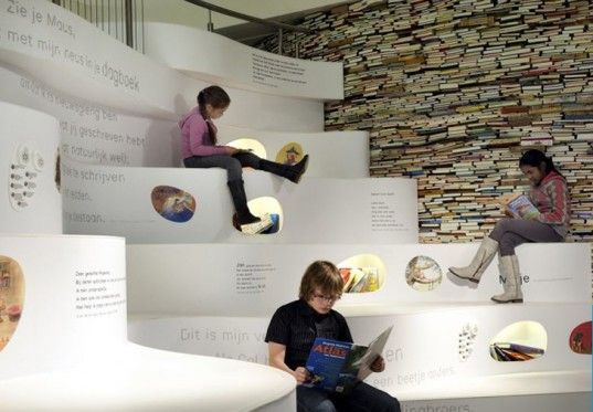 New exhibition in Children's Book Museum in the Hague. Room's upcycled walls are made from books. I like how the steps are used for displaying/storing information