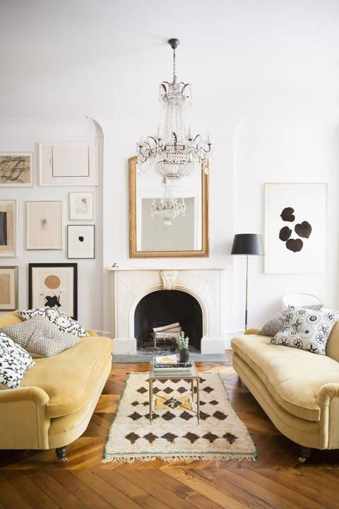 Gold couches in a neutral living room palette.