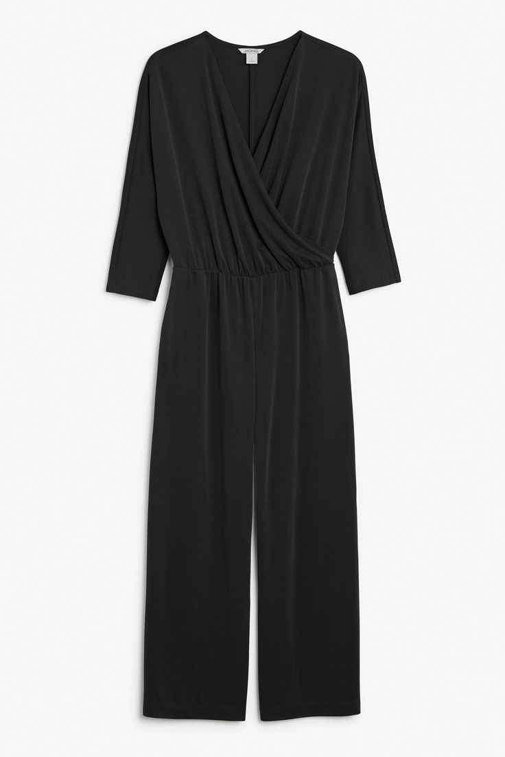 <p>Easy and beautiful. A classic wrap over drape design, flowing wide-leg fit and batwing 3/4 sleeves. A comfy, matte look fabric for that instant retro vib