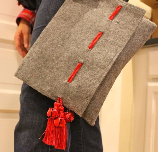 DIY holiday clutch: Jingle Bell Tassel | http://helloglow.co/diy-holiday-clutch-jingle-bell-tassel/