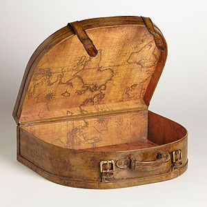 Store your keepsakes in our Antique Leather Half Round Suitcase to take a trip down memory lane whenever the mood strikes you. Handcrafted of faux leather with an antique map lining the interior, this travel-inspired piece costs less than you'd think, and is only at #WorldMarket.