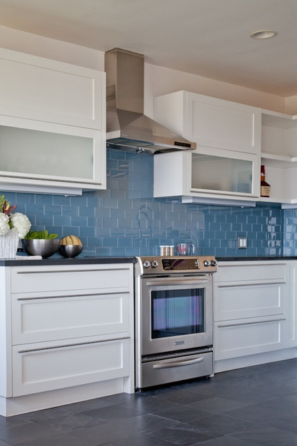Like the blue back splash, white cabinets with frosted glass on some, all drawers below.