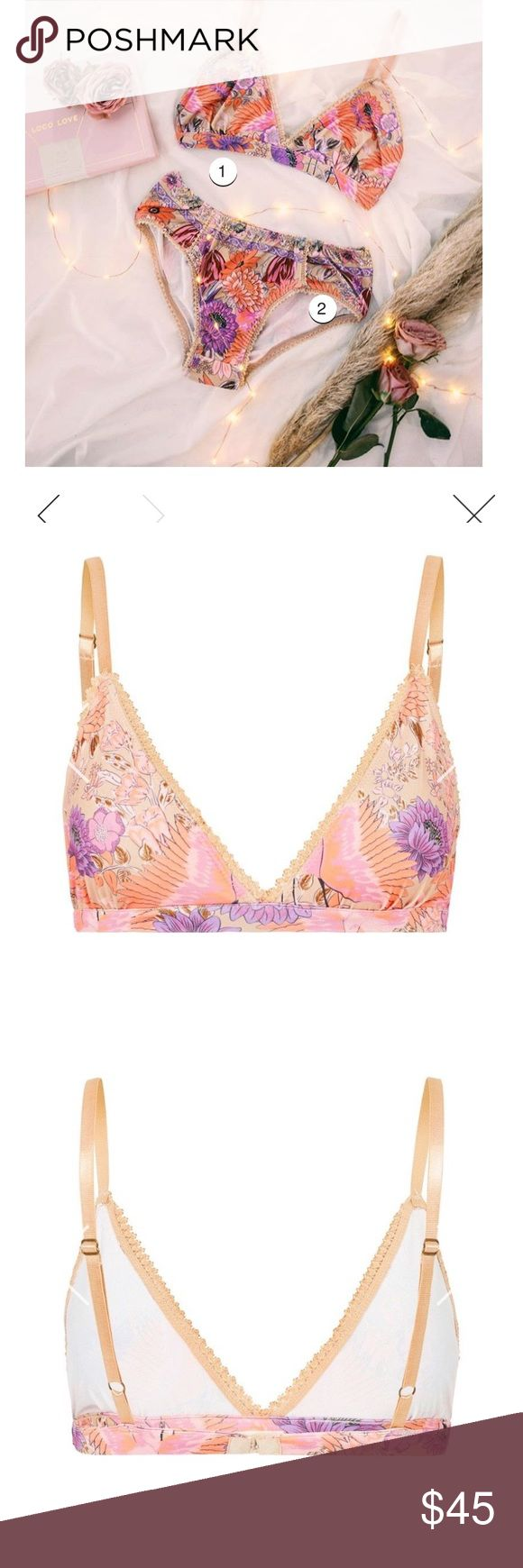 Spell & the Gypsy Collective Bralette/Panty Set Comfier than ever, the Siren Song Soft Tri Bralette is more of a traditional bra style with hook-and-eye closures at the back and adjustable straps, but better yet it is completely underwire free! inescapably summery with a blooming flamingo colored floral print against a cream colored polyester spandex - the Siren Song Bloomers are conveniently versatile, wear these beautiful briefs as swimmers for a quick dip or to bed as intimates on a balmy…