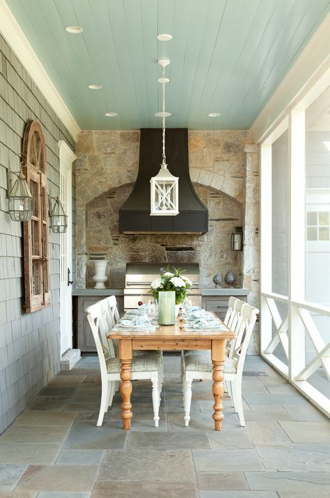 The screened-in outdoor kitchen features bluestone floor tiles and blue ceiling. Ceiling paint color is Benjamin Moore Silver Mist.