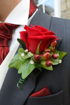 Red rose with hypericum berries and ivy leaves