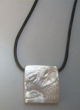 talismanes amuletos y símbolos   colgante sello maya perro Kin oc