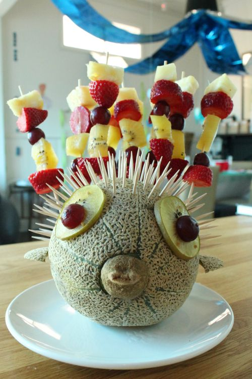 cantaloupe puffer fish with tooth pick and fruit kabob spikes and fruit eyes - Mermaid outfits, food, pinata...all of it.