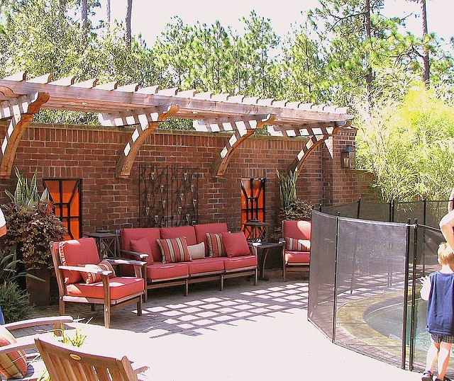 pergola off of fence- for above the outdoor couch?