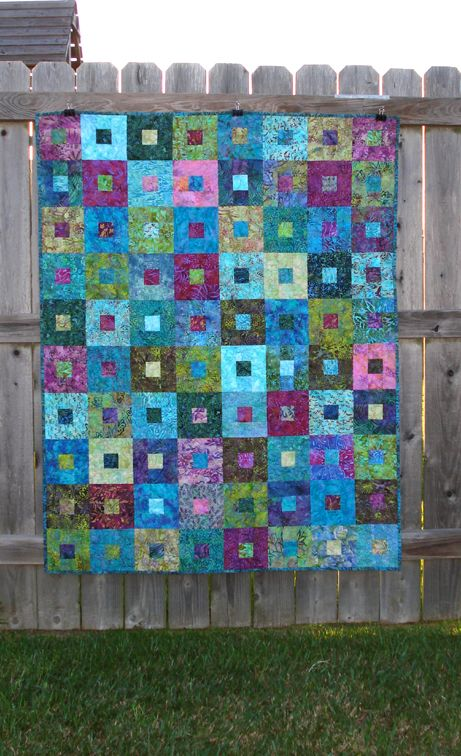 Blues and greens and purples and a simple Square in a Square quilt block: beautiful!