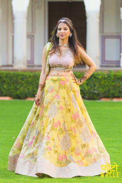 Light Lehengas - Yellow and Pink Floral Light Lehenga | WedMeGood | Yellow Cotton Lehenga with a Cutwork Beige Blouse and Yellow Dupatta #wedmegood #Indianwedding #indianbride #yellow #floral #lehenga