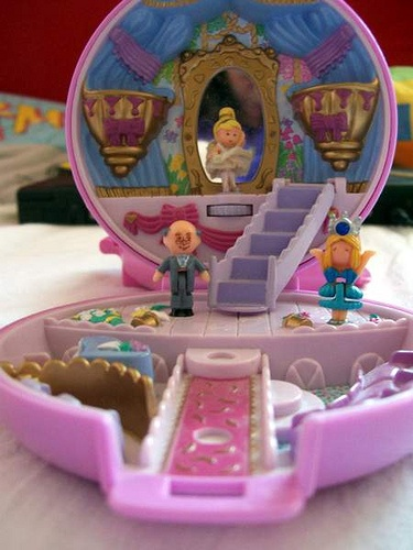 Polly Pockets! The Pollys were so small, I dont know how we didnt choke on them!