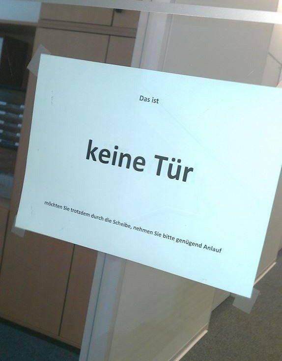 Thank goodness I understand German lol, translation: This is not a door.