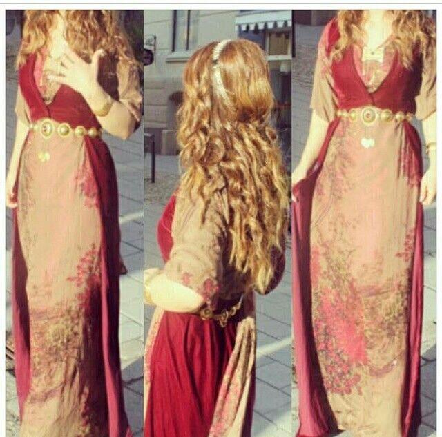 Traditional kurdish woman dress. Love the color combo.