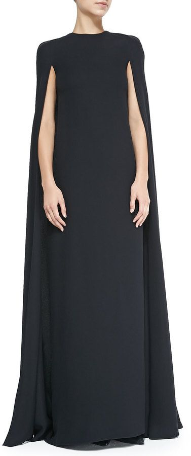 Valentino Silk Cape Gown.  Available is sizes 4, 6 & 12 Jewel neckline. Sharp shoulders. Floor-length cape. Column skirt. Hidden back zip. Silk. Made in Italy. $6990.00