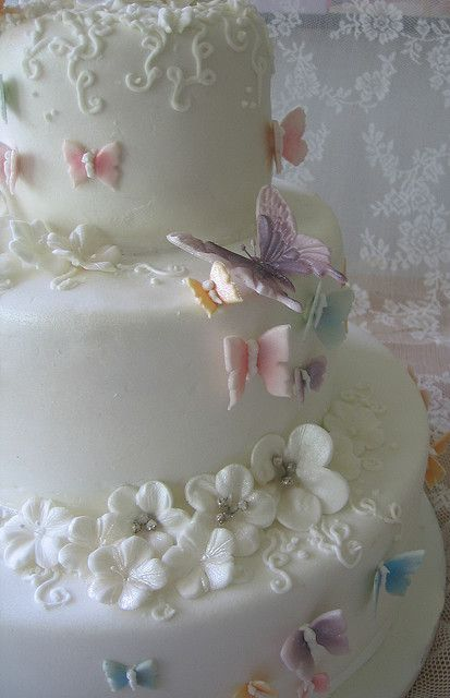 This butterfly wedding cake is adorable. Years ago, I chose a heart shaped cake for my wedding. It was beautiful and artistic. Unfortunately, we no longer use that bakery because of rude counter help when we were trying to order a birthday cake. (Not the maker of this beautiful cake.)