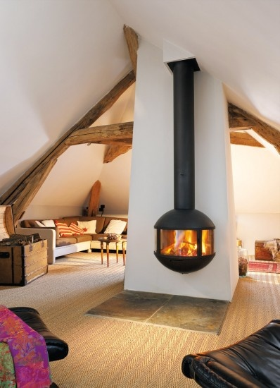 Sweet fireplace in a huge attic hang out