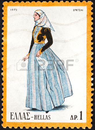 GREECE - CIRCA 1973: A postage stamp printed in the Greece shows woman in Greek national folk dress, circa 1973 photo