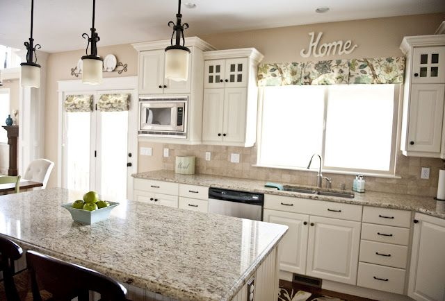 love the granite color with the white cabinets! inspiration for our upcoming kitchen remodel!