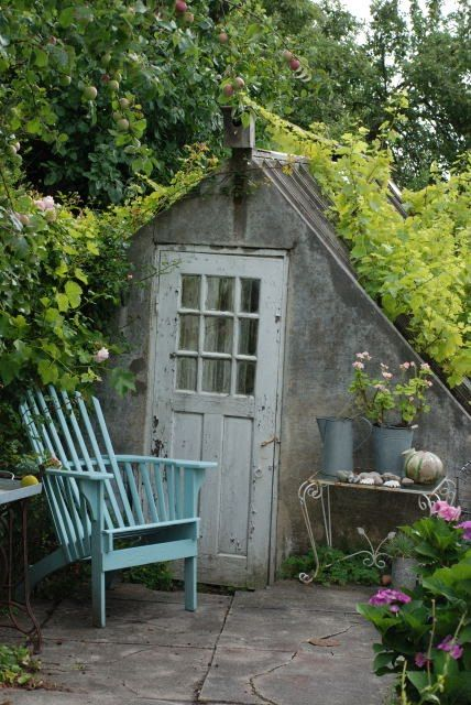 Neat little shed with blue chair could be a potting shed for Garden shed jokes