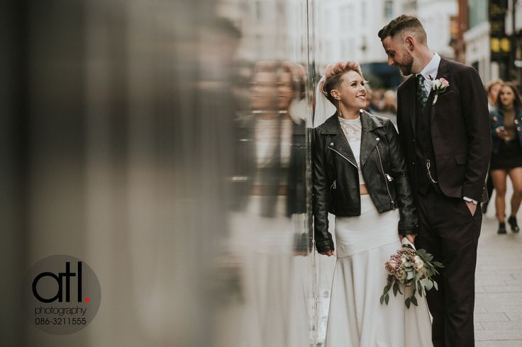 Jenny & Orey enjoyed a few quiet moments together on Grafton Street after their nuptials at City Hall, Dublin before making their way to Fallon & Byrne to start the celebrations with family & friends.  Wedding Photography & Videography by ATL Photography  www.atl-photography.com