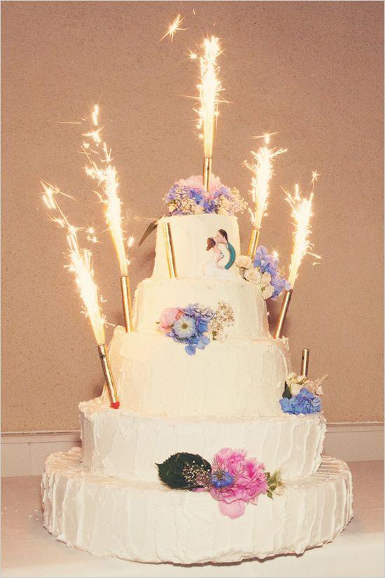 Sparkler topped wedding cake. Anne-Claire Brun http://www.weddingchicks.com/2014/06/05/vintage-chic-french-wedding/