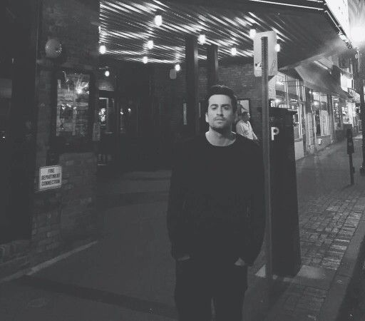 Dotan next to a sign