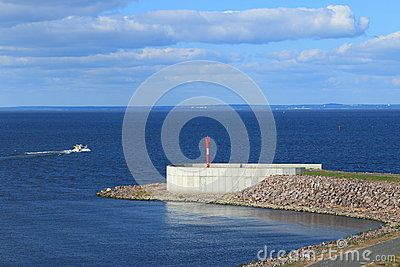 The breakwater alignment with the sign denoting the right side of the navigable part of the protective dam on the Gulf of Finland. Saint-Petersburg, Russia