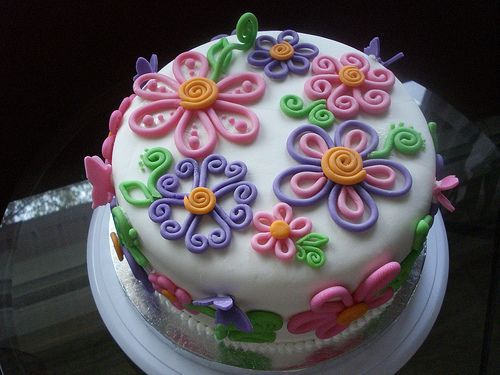 Mothers day cake by cupcakes and butterflies