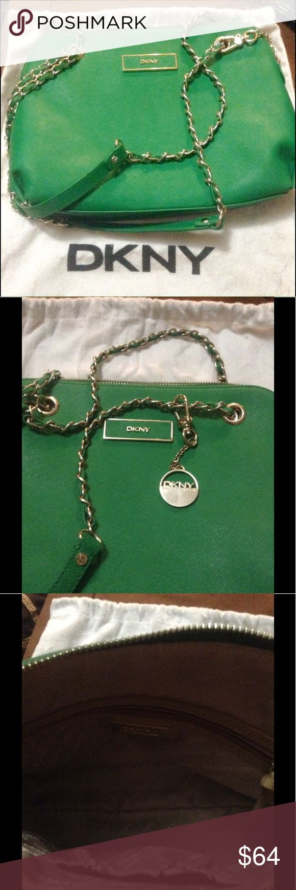 DKNY beautiful Green Shoulder Bag or Cross Body Can be worn as a cross body or used as shoulder bag.  Mint Condition! No flaws that I can see.  Used only a couple of times. Comes with dust bag. Dkny Bags