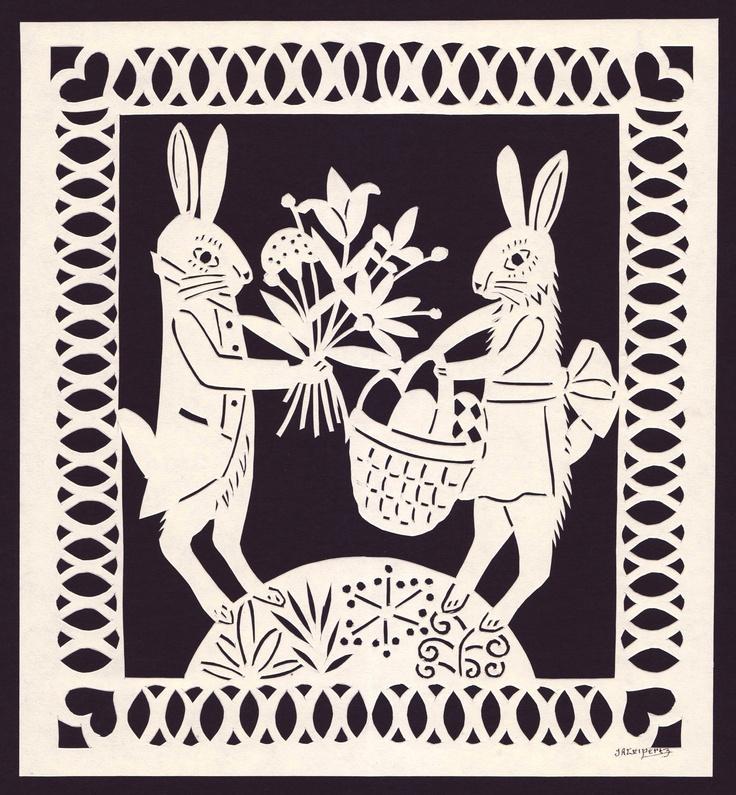 Bunny Rabbits With Easter Basket & Flowers Hand Cut Paper Scherenschnitte. $25.00, via steelbrush Etsy.