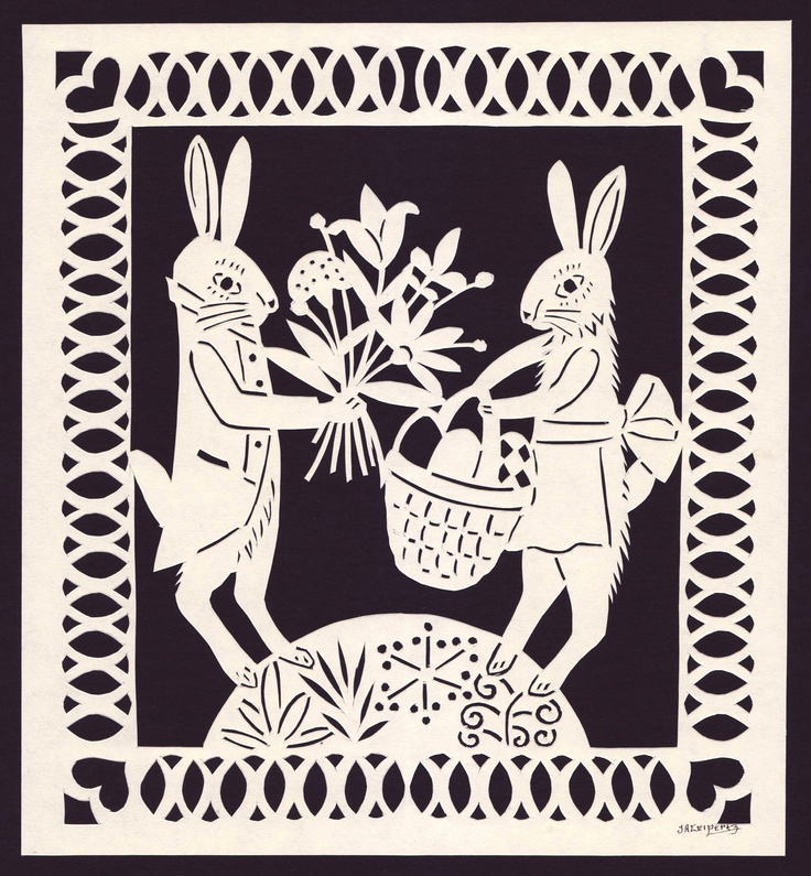 Bunny Rabbits With Easter Basket & Flowers Hand Cut Paper Scherenschnitte. $25.00, via steelbrush Etsy.