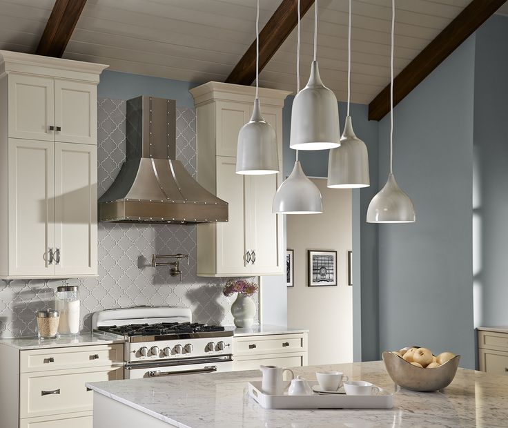 A unique mix of feiss dutch pendants hung at different heights to create a unique and visually interesting lighting focal point