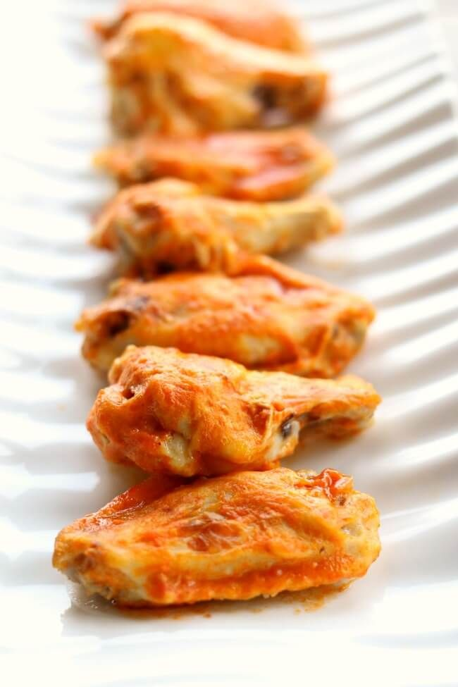 Slow Cooker Buffalo Wings--throw a bag of frozen chicken wings in your slow cooker and walk away for a few hours. Then baste the wings with delicious buffalo wing sauce and broil in your oven for a few minutes and you have super tender and flavorful wings with minimal effort.