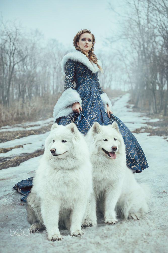 The woman on winter walk with a dog by Evgeniya Litovchenko on 500px