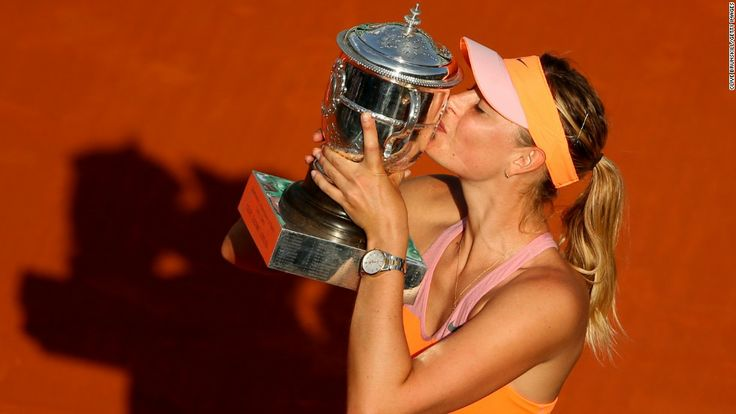 Maria Sharapova kisses the Suzanne Lenglen Trophy after winning the French Open on Saturday, June 7. Sharapova defeated Simona Halep to clai...