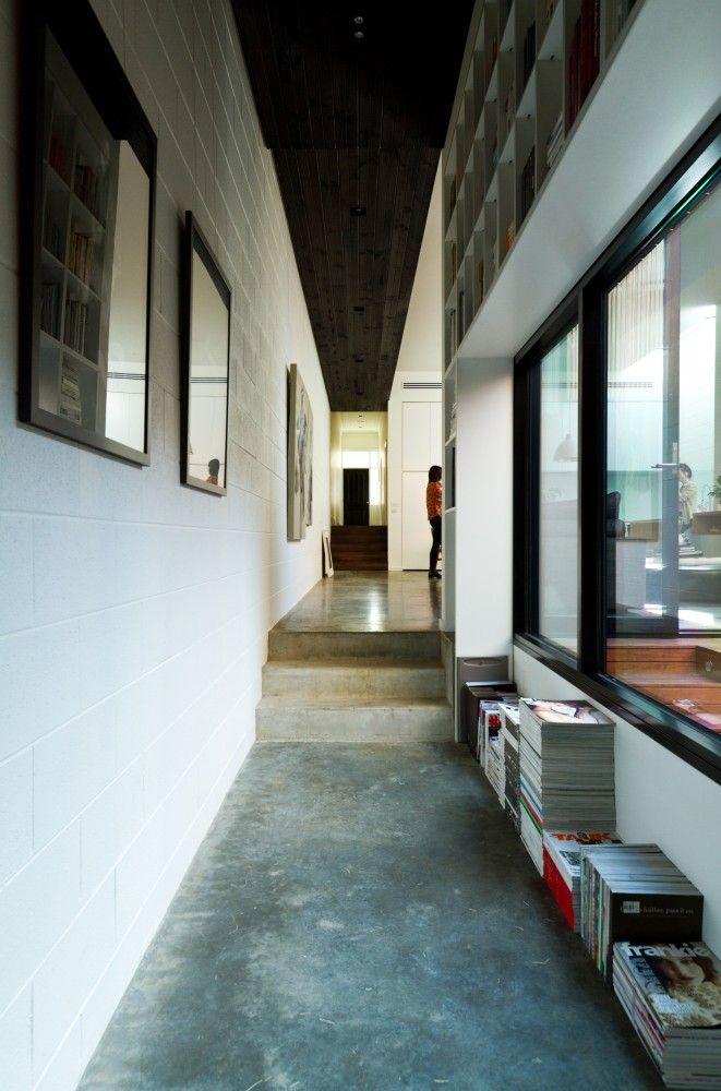 polished concrete floor and black-fraem windows. Parure House / Architects EAT
