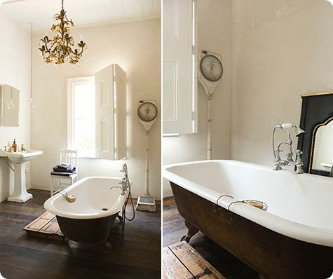 Light airy bathrooms with wood details and the kicker a claw foot tub