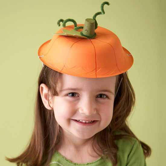 Make a Halloween pumpkin hat for your kid from a paper bowl, paint, and other crafting basics.