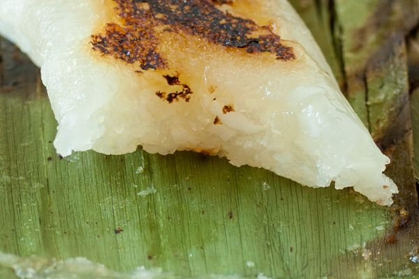 APIGIGE' RECIPE - a tapioca and coconut dessert, grilled in banana leaves. Some people make it with mature coconut while others use the young coconut.