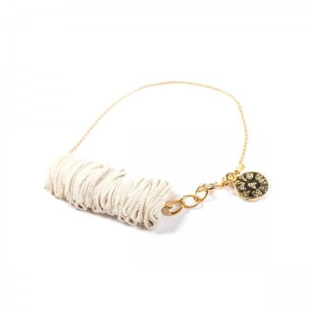 Bracelet featuring leather, chain and golden brass. Jewels have interesting and voluptuous shapes, they are handmade, engraving and pleating colored leather elements, which, attached, create small or big ruffles. Soft to the touch and with harmonic forms.