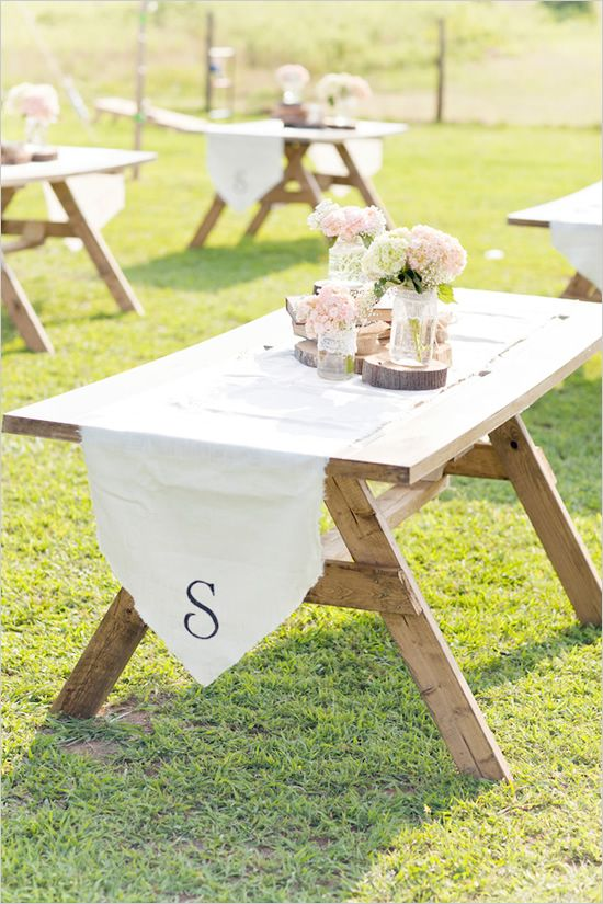 personalized table runner. Would do these in burlap easy to make tables with old doors and saw horses. Then rent the chairs.