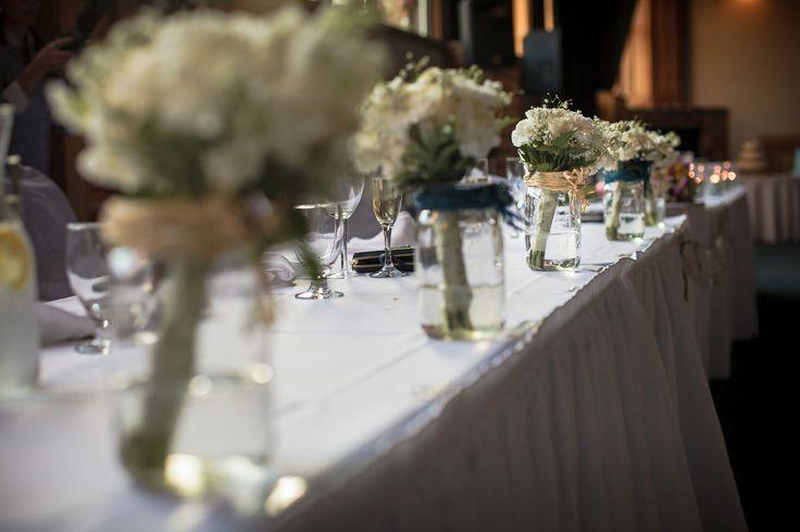 Head Table Decor - bridesmaid bouquets in mason jars, rustic wedding