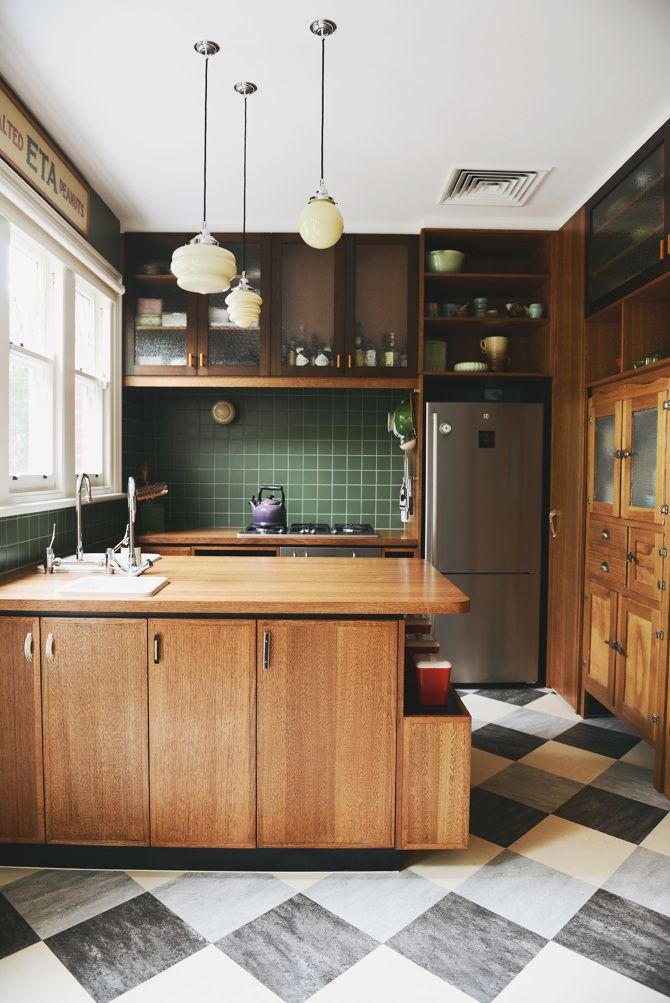 Art Deco influenced kitchen. Love the green tiles, pendant lights and Peanut sign. Designed by HEARTH, Melbourne Australia.