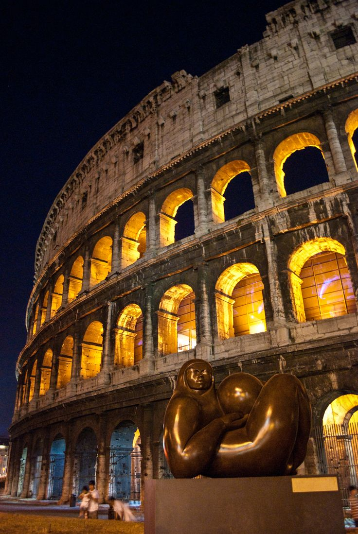 The Roman Colosseum at night - Rome, Italy