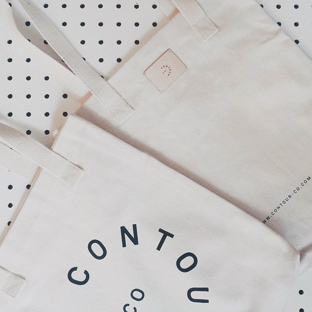 Front & Back of our screen printed totes featuring a leather Contour & Co. tag. Available this Sunday at the Lesliville Flea. and online soon at: http://www.contour-co.com