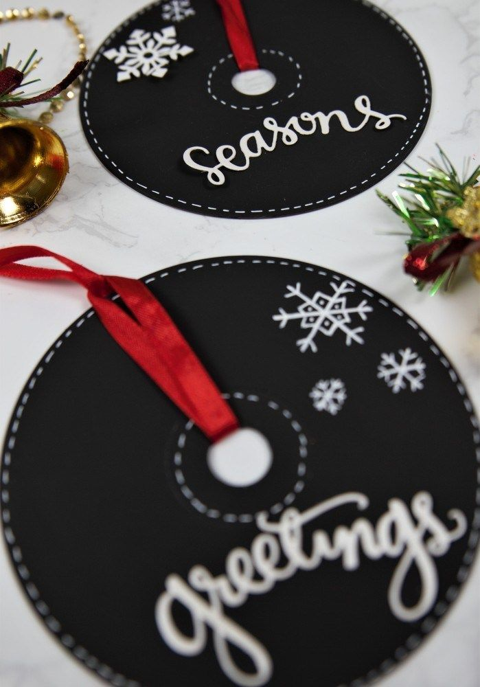 Deck up your Christmas Tree the DIY way with these pretty Chalkboard Paint CD Ornaments! Perfect to keep for yourself or to give as holiday gifts! #christmas #recycledcraft #CD #chalkboardart #ornament
