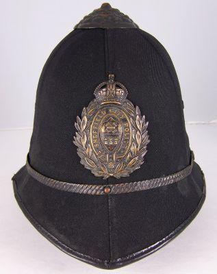 Sheffield City Police Helmet  Sheffield City Police helmet; early 20th Century; six panel cloth covered cork helmet; blackened helmet fittings