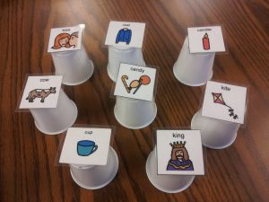 "speech therapy activity for a question asking goal: Hide a preferred item under a cup - student asks,""Is it under the ____?"" Choose target words for sentence level practice."