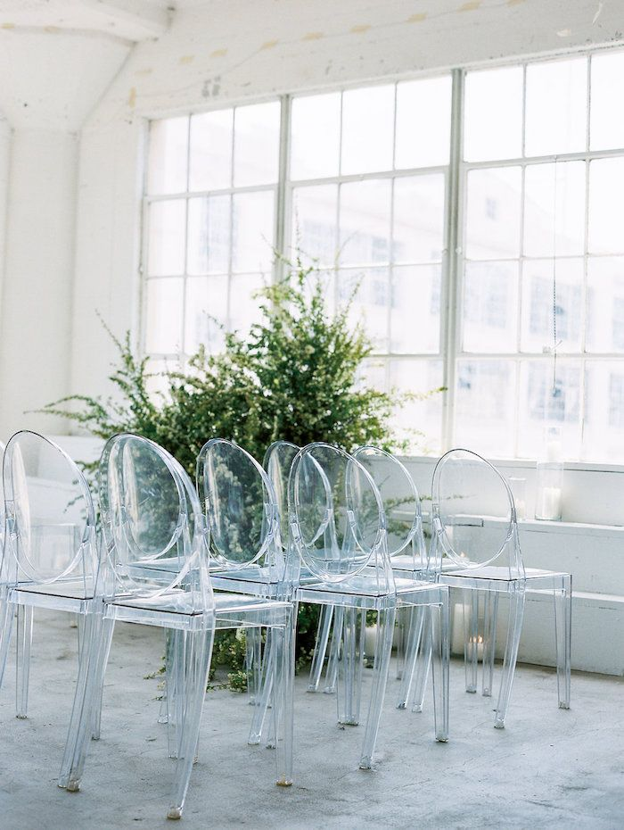 clean white modern ceremony design, ghost chairs